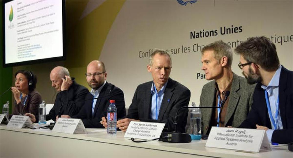 Paris climate conference prolonged, scientists sound an alarm