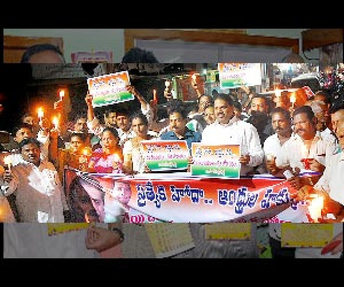 Cong leaders take out candle rally for Special Status