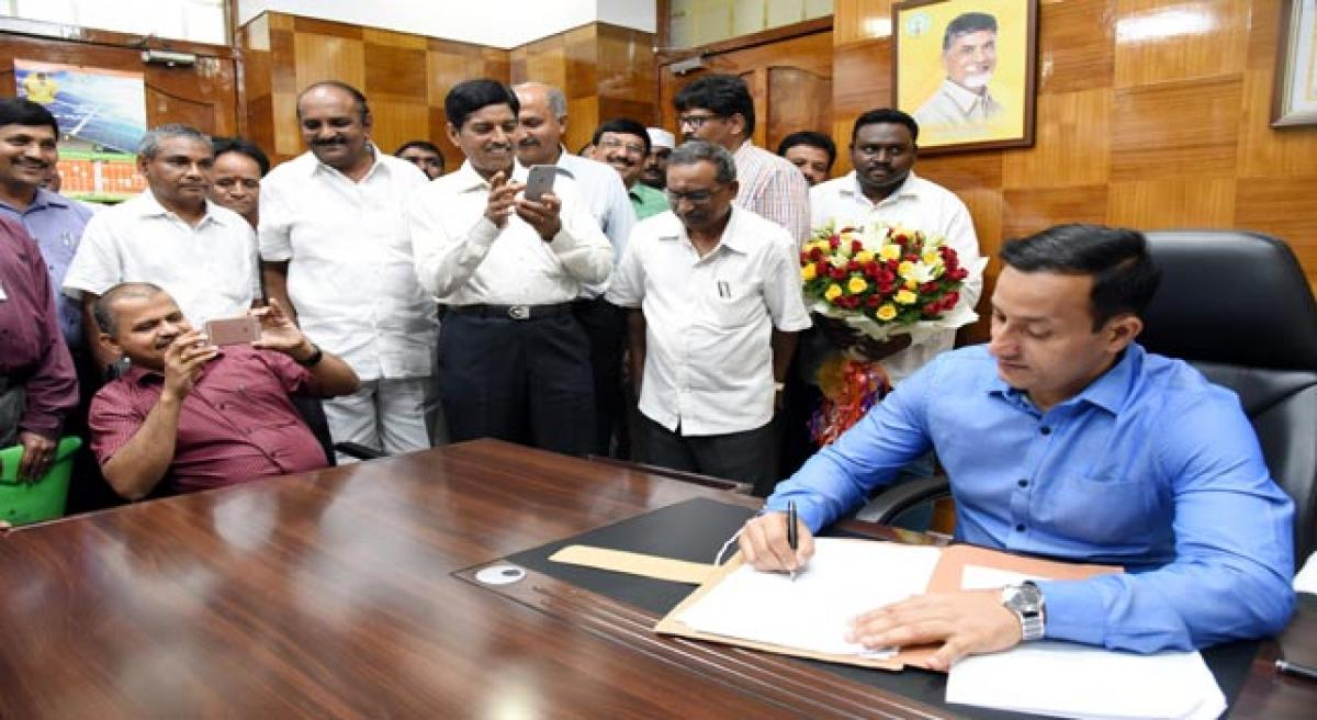 Praveen takes charge as Collector.