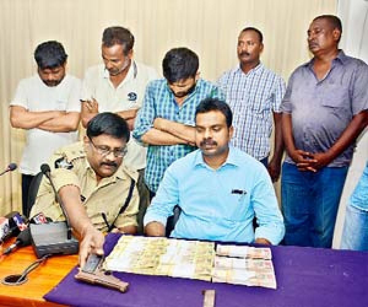 Fake currency, pistol seized