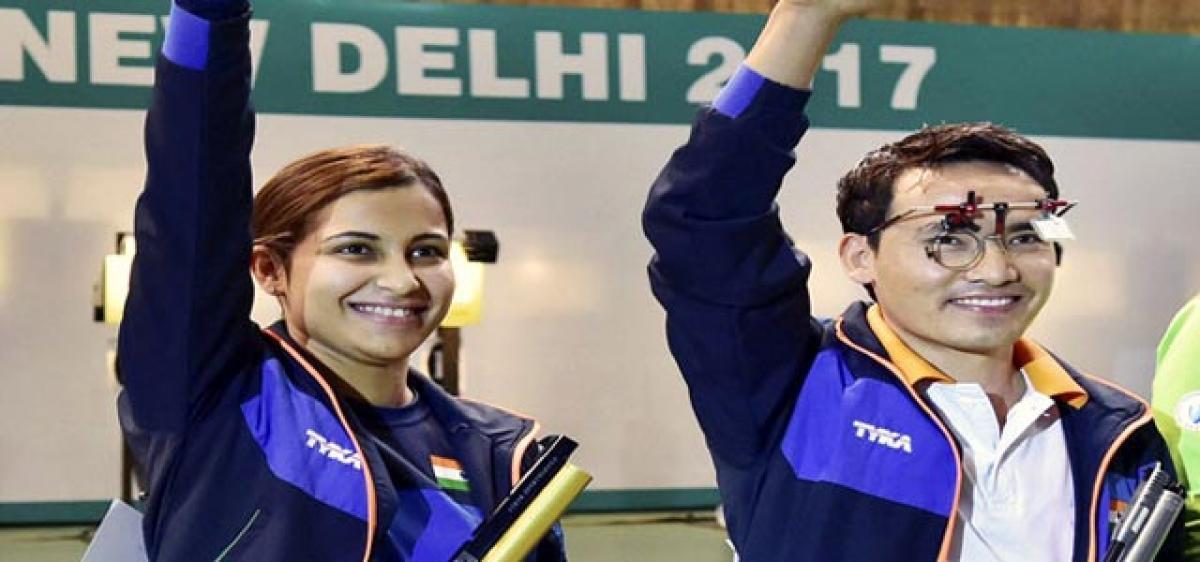 Jitu, Heena bring cheer to Indian camp