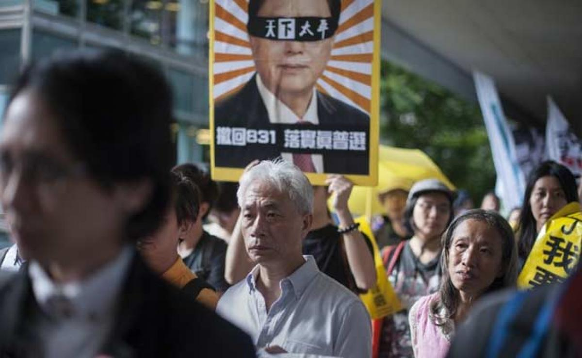 Pro-Democracy Activists March Before Hong Kong Chief Executive Vote