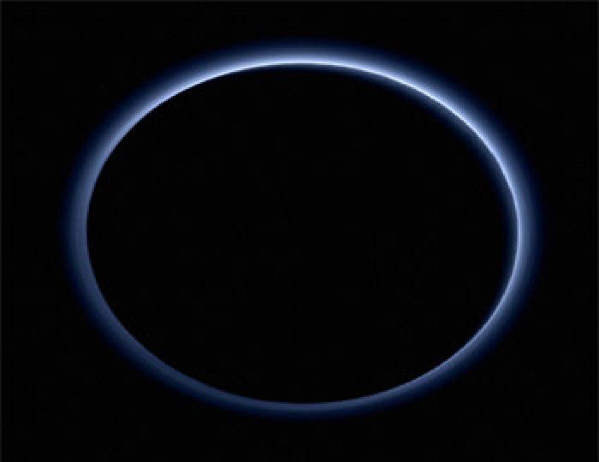 Blue skies, water ice on Pluto