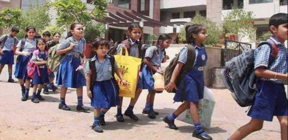 Telangana Govt agrees to continue half day schools