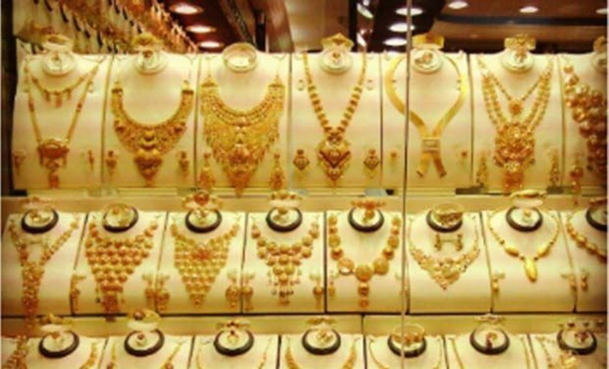 Gold futures drop Rs 26 on weak global cues, silver falls by Rs 78