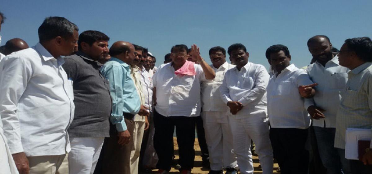 Minister Pocharam slams Cong leaders