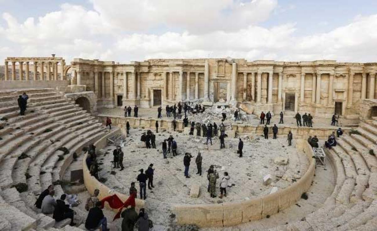 Atop Palmyras Damaged Theatre, Syrian Musicians Sing Of Return