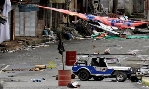 Militants in Philippines city dug in for protracted battle