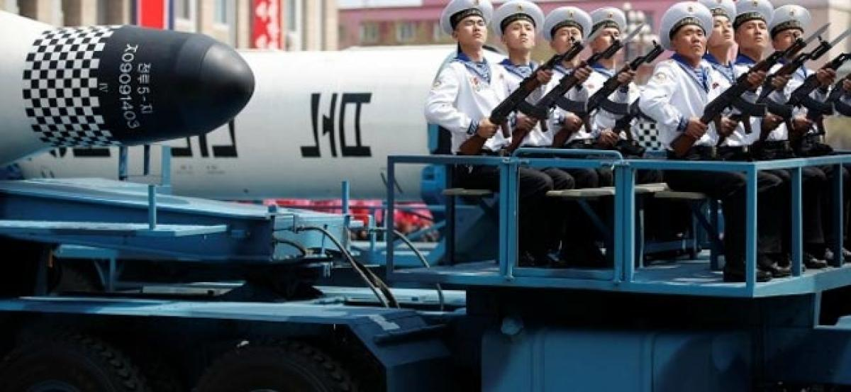 North Korea rolls out intercontinental ballistic missiles, other weaponry at parade