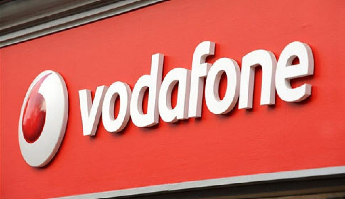 India signs six deals with Britain, including Vodafone investment