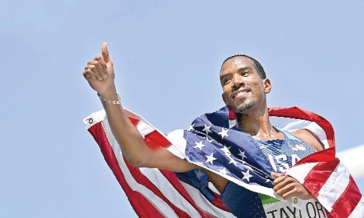 Taylor retains triple jump gold