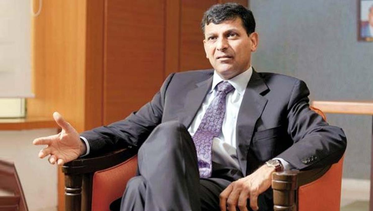 RBI tackling inflation: Rajan