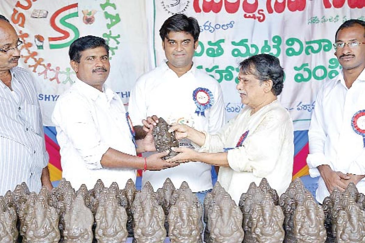 Clay Ganesh idols distributed