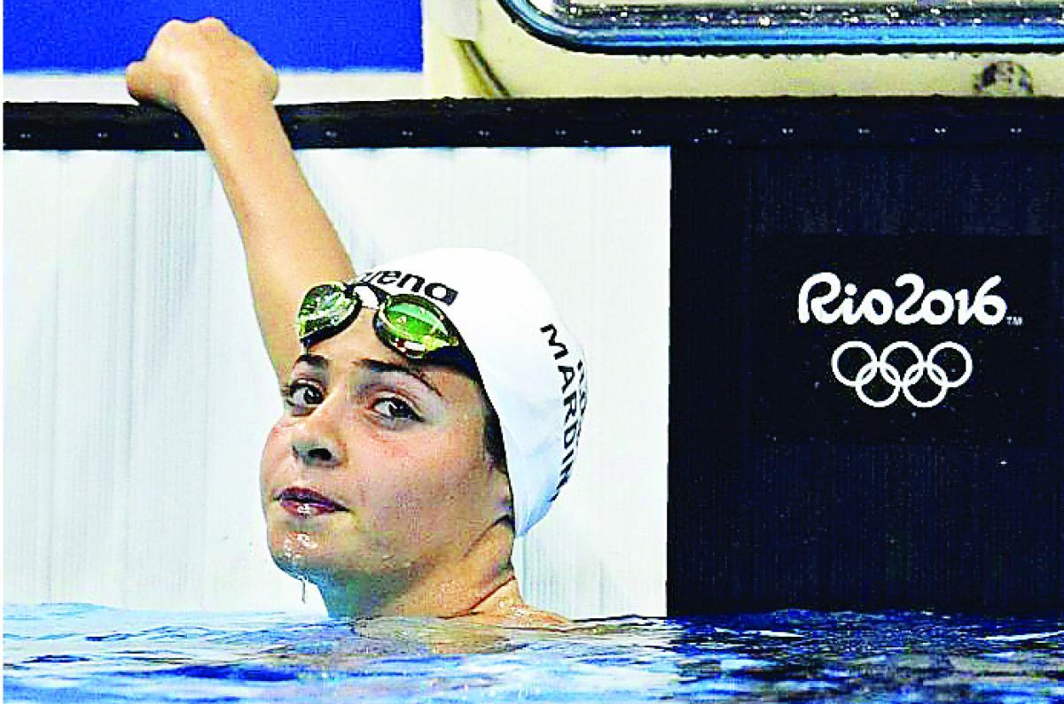 Refugee swimmer wins hearts
