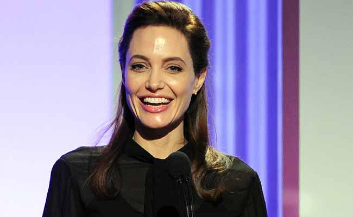 Angelina Jolie Appeals For Commitment To
