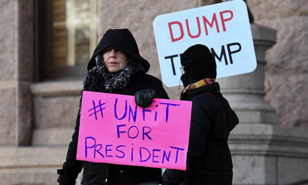 California marchers protest against Donald Trump as US Democrats vow policy fight