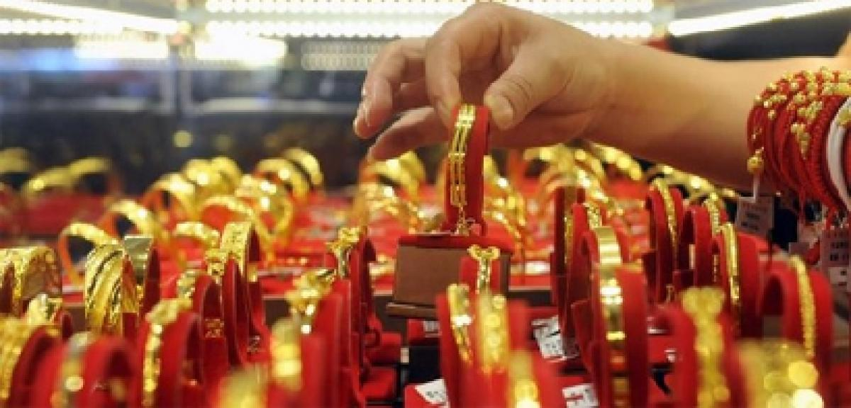 Gold down on equities rally