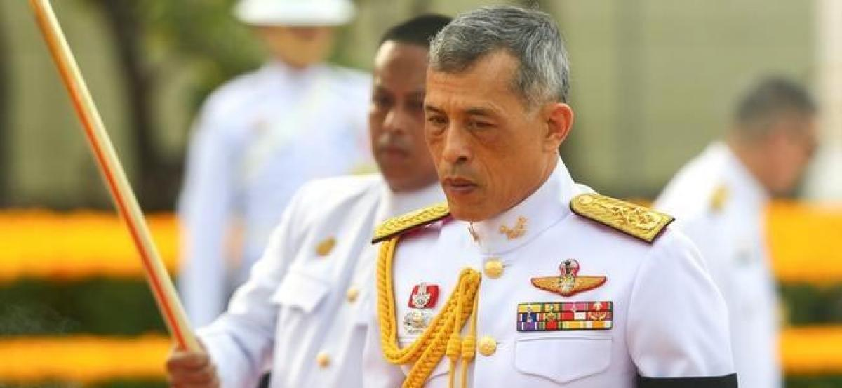 Thai king signs constitution in step towards poll