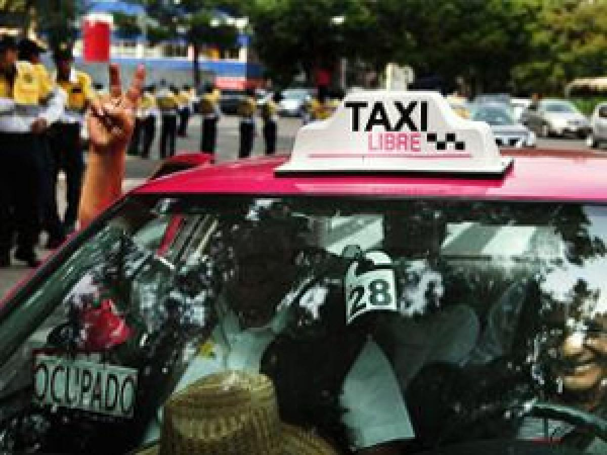 Mexico taxi drivers step up pressure against Uber