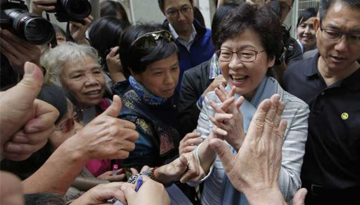 Beijing favourite Lam becomes Hong Kongs new leader