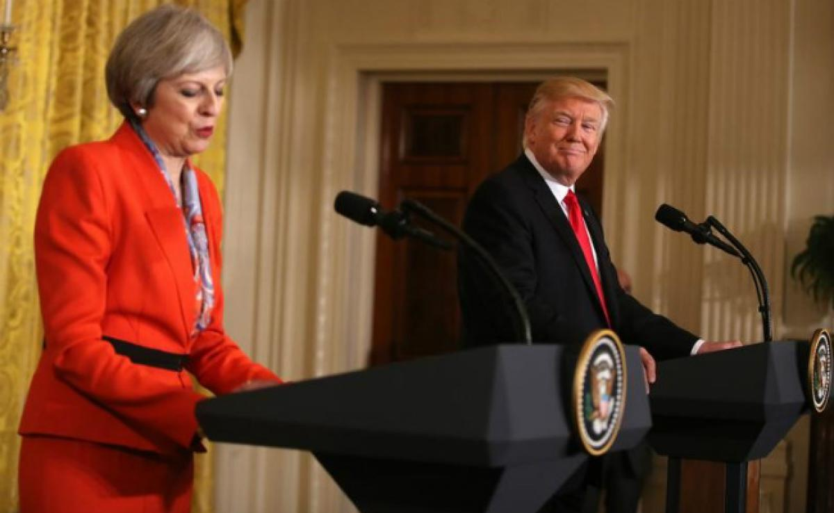 Theresa May, Donald Trump Agree Russia Should Break Ties With Syrian President Assad