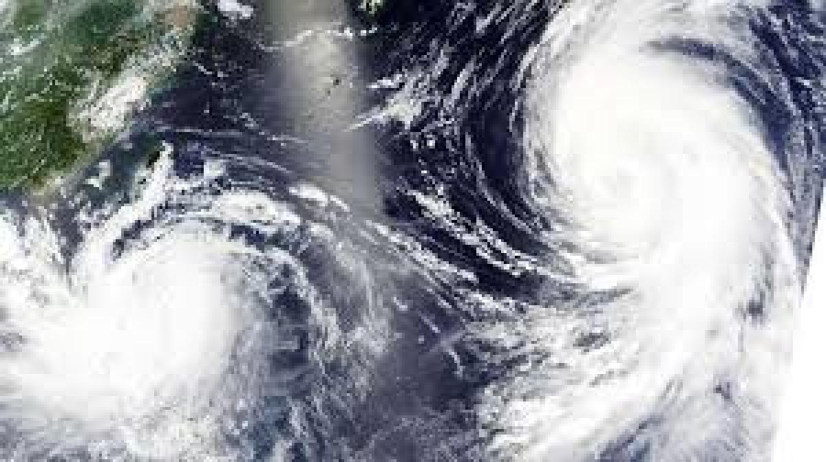 Twin typhoons approaching Japan