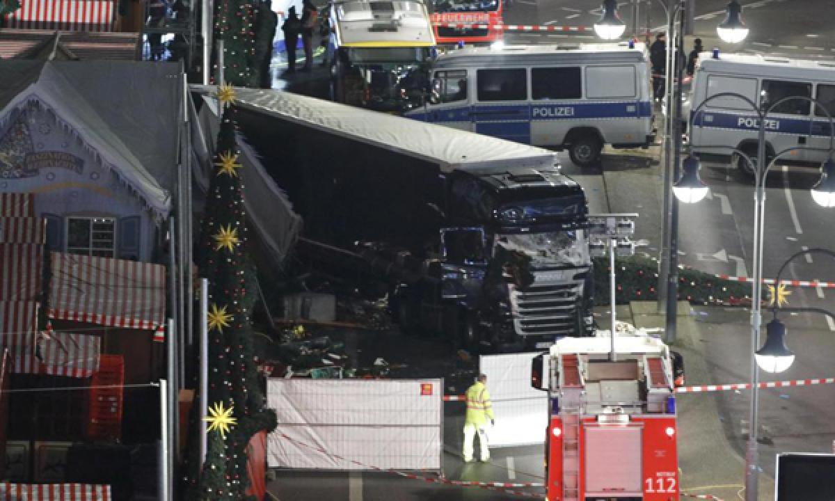 Truck ploughs into crowd at Berlin Christmas market killing at least 12 and 48 injured