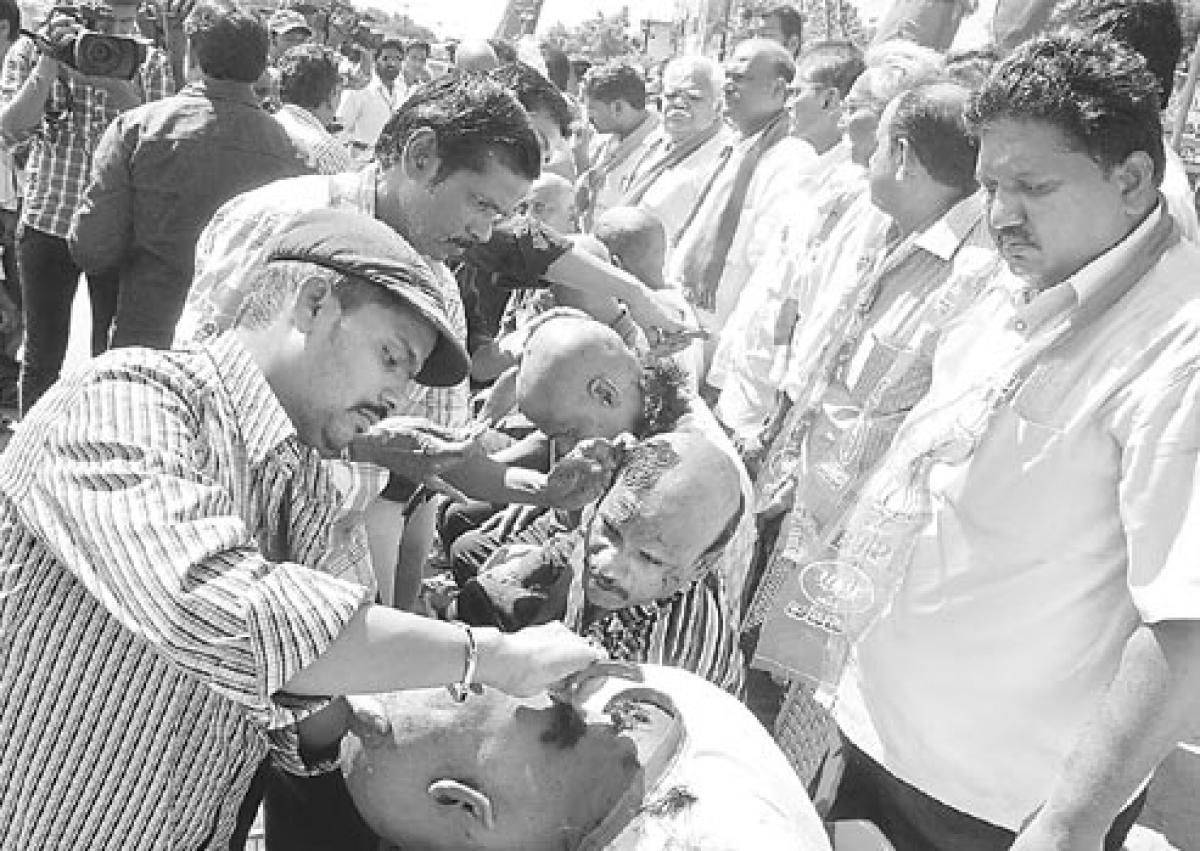 BJP activists tonsure to highlight sub-ways issue