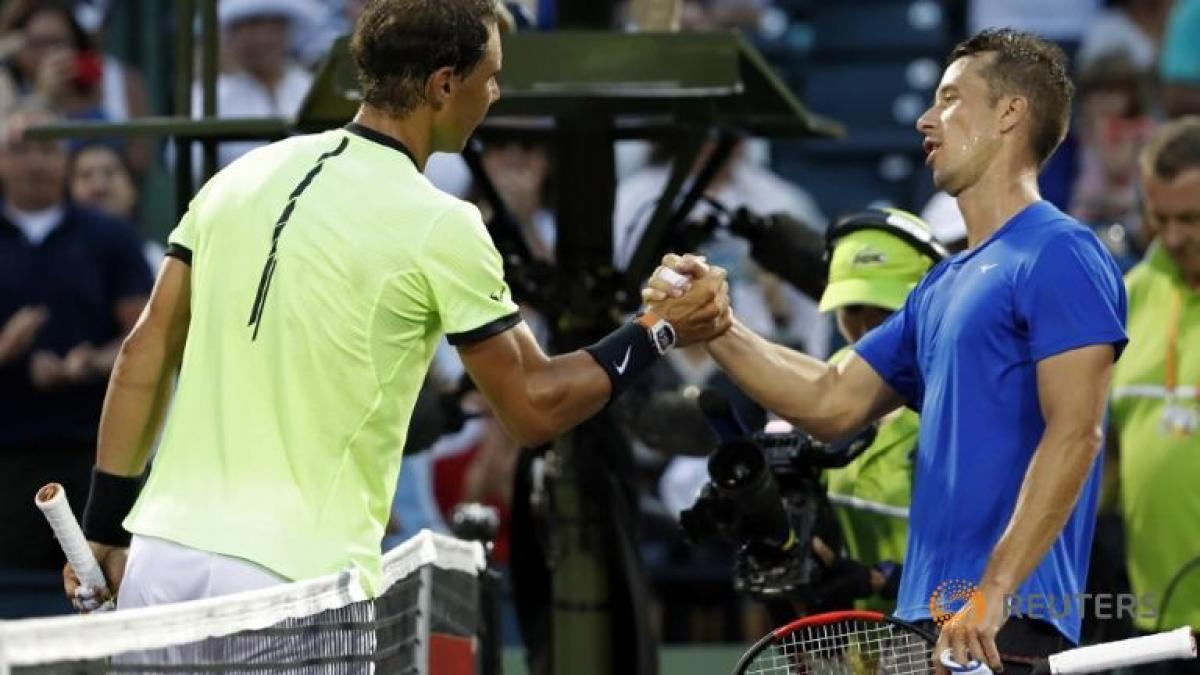 Nadal wins in 1000th match, Raonic withdraws