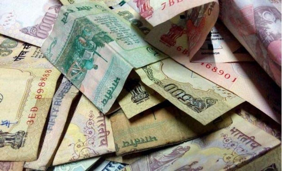 Rupee marginally up at 66.02 against dollar in early trade