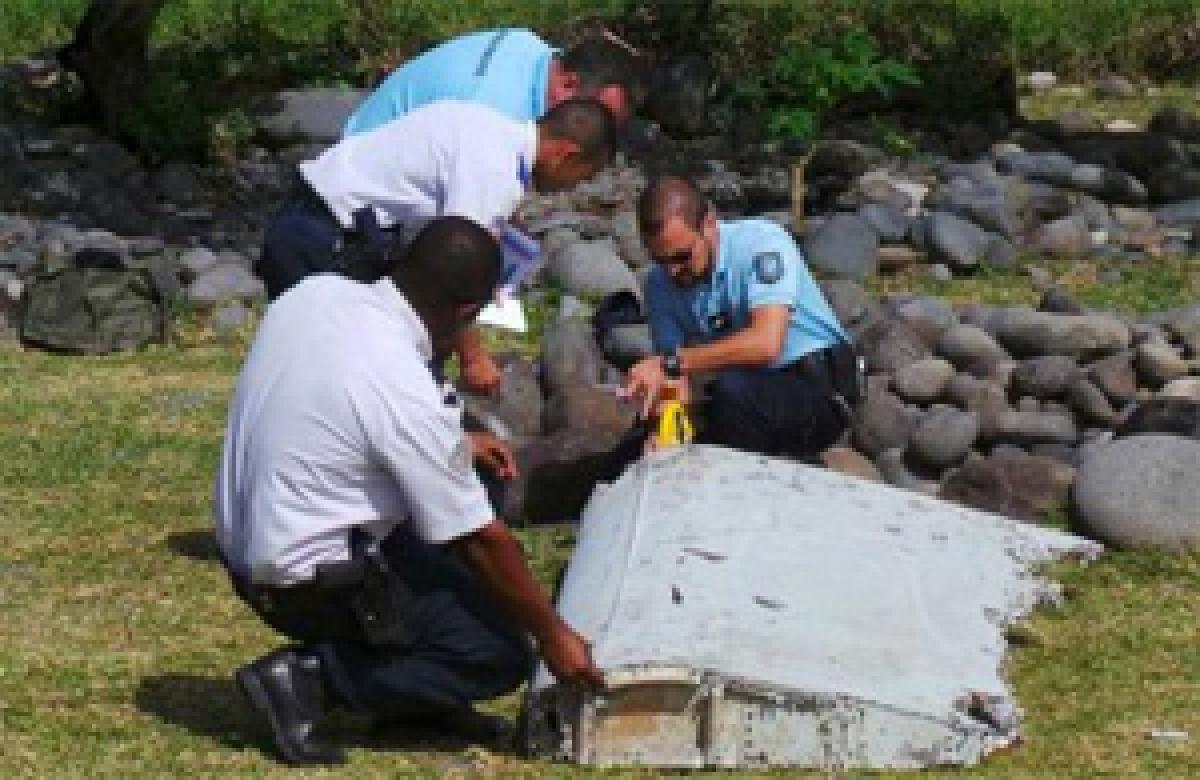 Australia completes initial inspection of wing piece from MH370