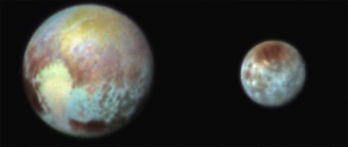 Plutos big moon Charon reveals colourful, violent history