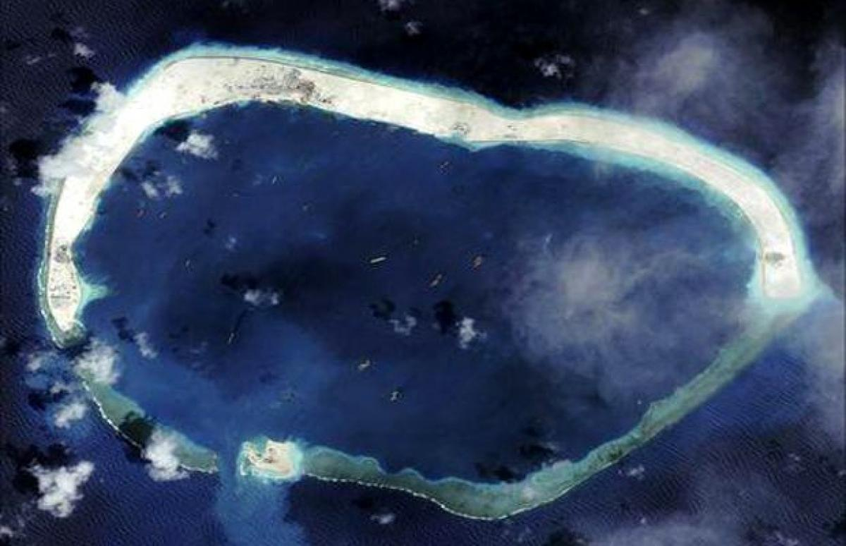 China appears to be working on third airstrip on disputed South China Sea islets: expert