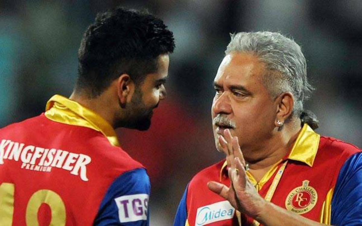 Vijay Mallya drops in at Virat Kohli event; Indian team avoids him