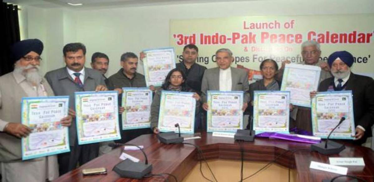 Indo Pak school children paint peace message