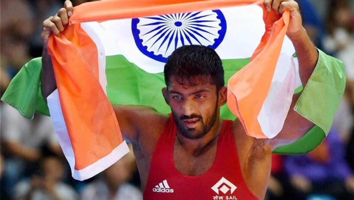 Wrestler Yogeshwar Dutt doesnt wish to collect the silver medal from Russians family