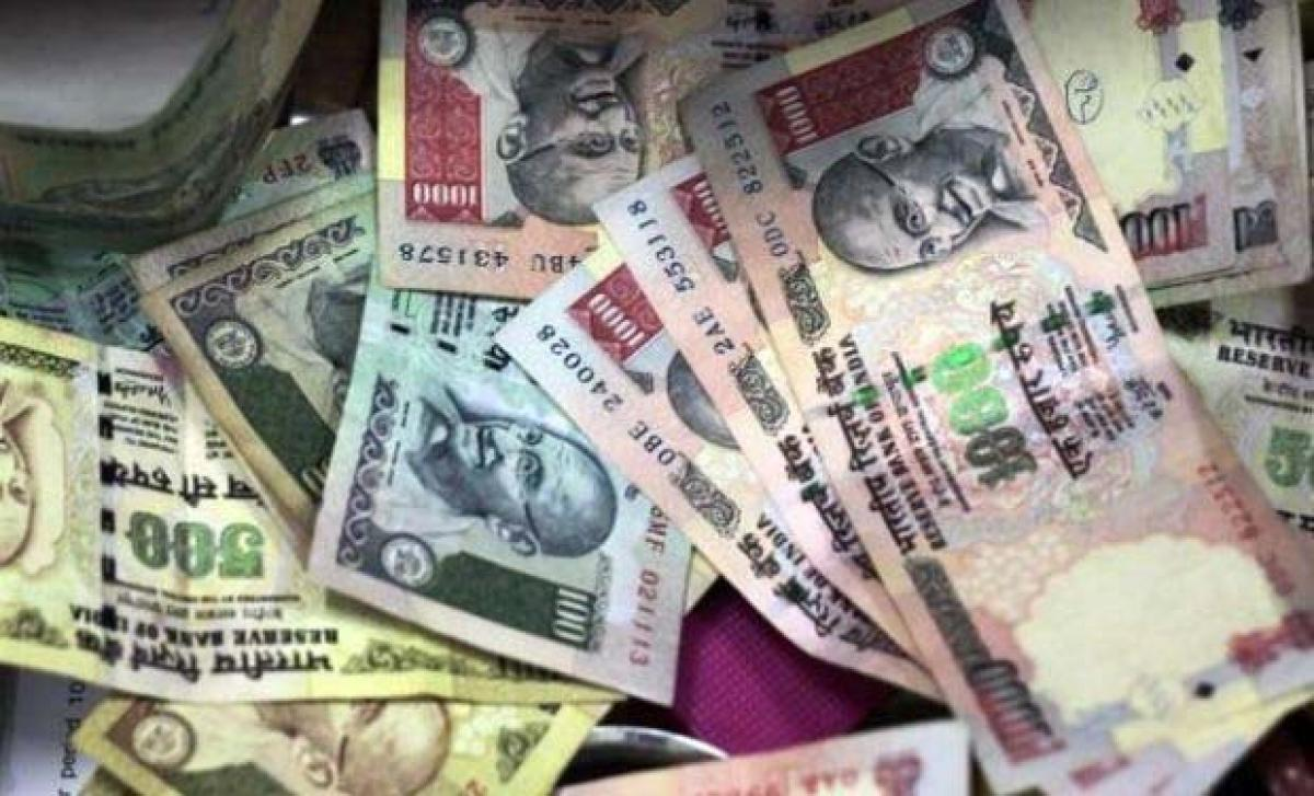 Rupee weakens 18 paise against dollar