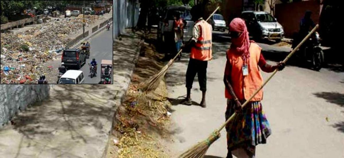 MCD sanitation workers dump muck on streets, go on strike