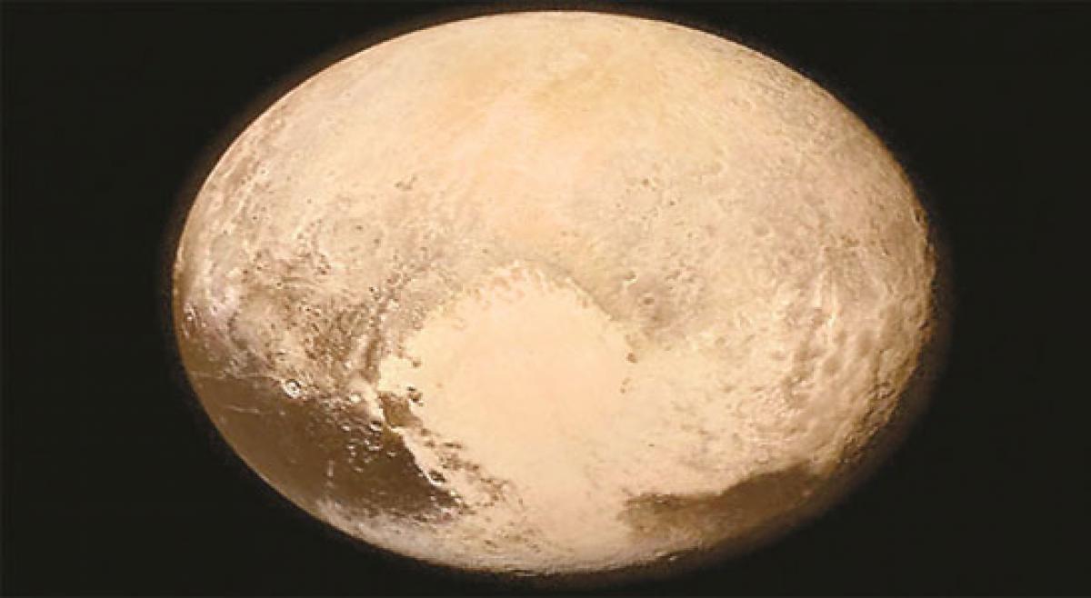 Pluto's frozen surface may hide a vast liquid ocean