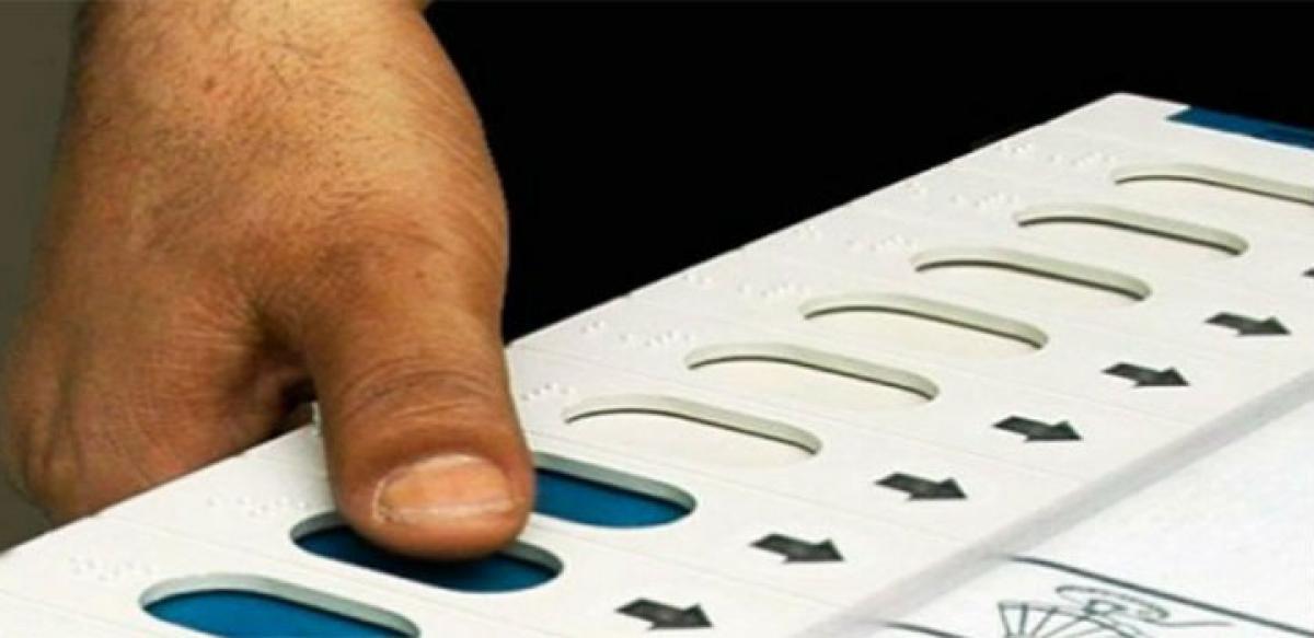Bihar exit polls predict close finish
