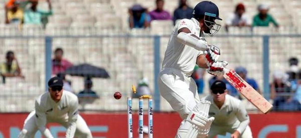 Pujara, Rahane lift India after poor start