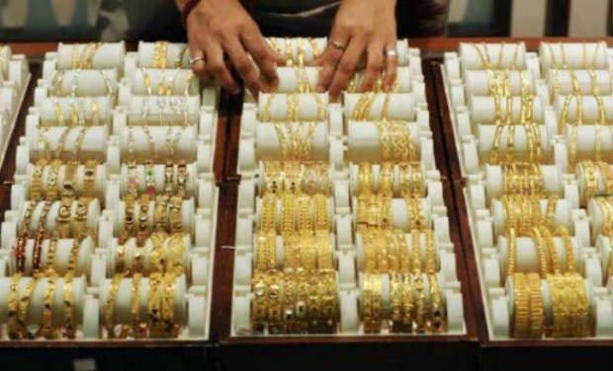 Gold sparkles to near one-month high on festive demand
