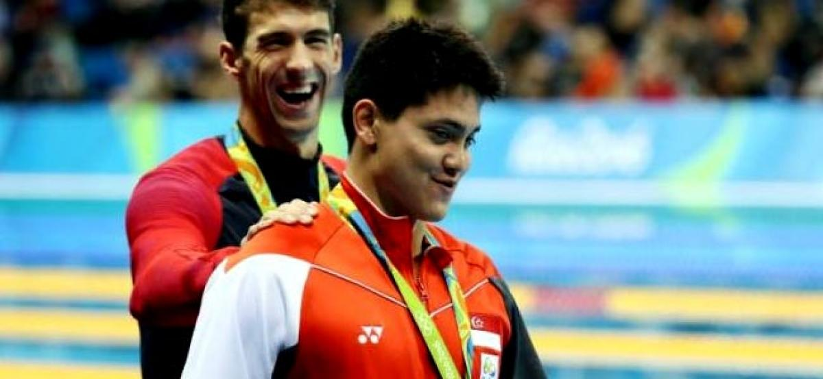 Swimming: Schooling wins Singapores first gold