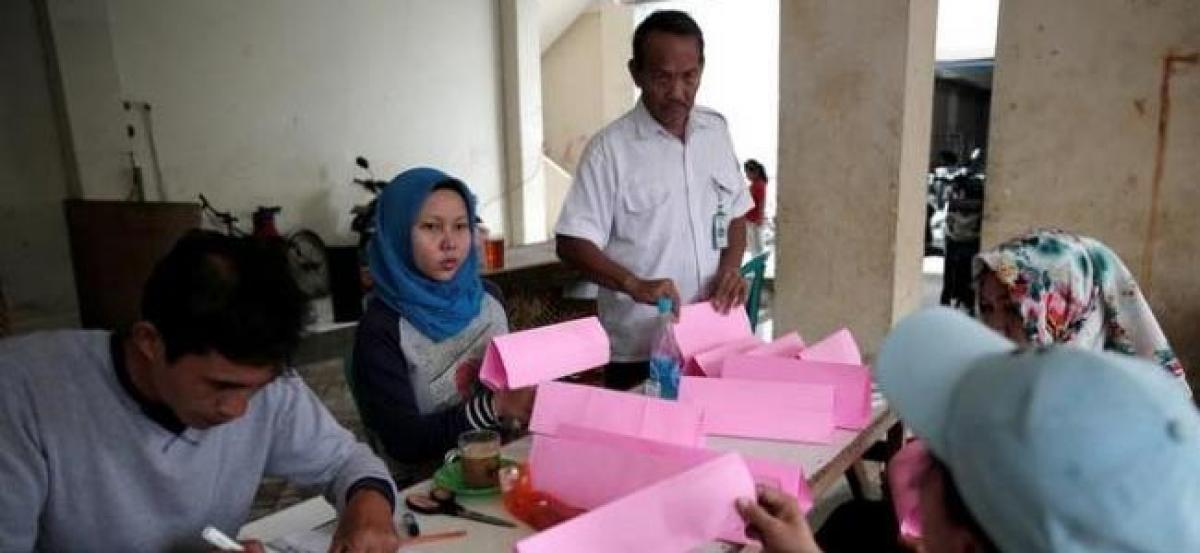 Election in Indonesian capital heads for run-off after tense campaign