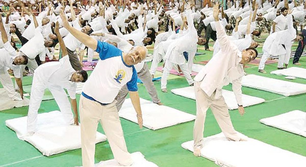 Strive for a peaceful world through Yoga: Ashok