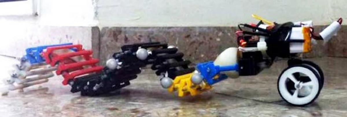 This wave-propelled robot can swim, crawl and climb