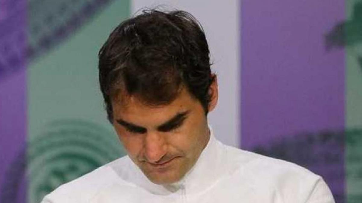 Stunned Roger Federer Vows to be Back at Wimbledon