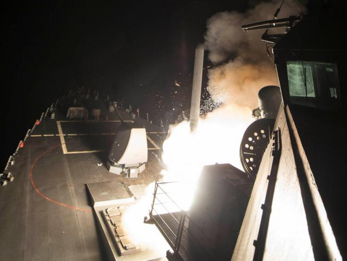 U.S. fires missiles at Assad airbase, escalating role in Syrian war