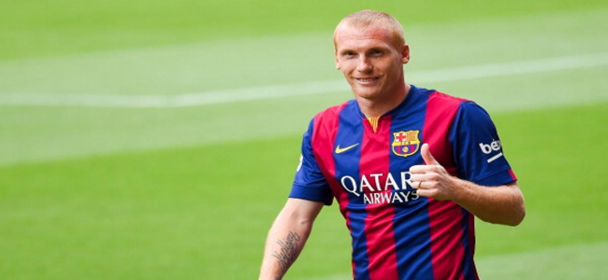 Jeremy Mathieu returns to Barcelona training