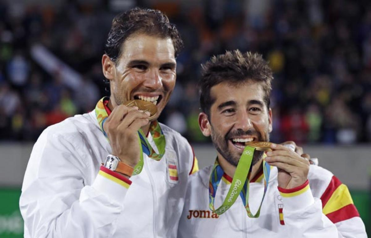 Rafael Nadal wins doubles gold, comes closer to singles glory